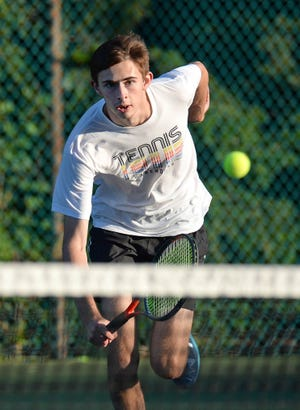 Grayson Millette, shown competing in the 2020 City Rec tennis tournament, is the returning District 10 Class 2A singles champion from 2019.