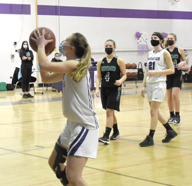 Gabby Sylstra takes the first shot for the Mounties Monday on Senior Night in Little Falls. Sylstra had knee surgery in September and had missed all of her final scholastic soccer and basketball seasons before making a brief appearance in the one home game.