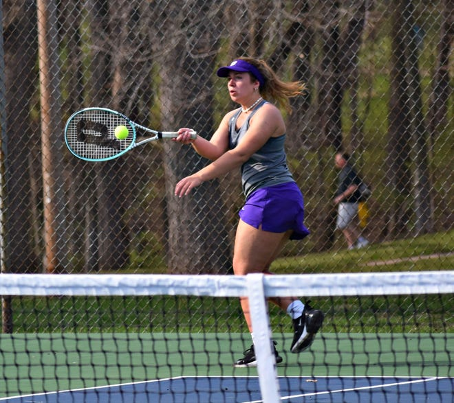 Burlington High School's Kayla Norton returns a serve against Fort Madison's Molly Knipe in No. singles in a dual meet at Dankwardt Park Monday. Knipe won the match.