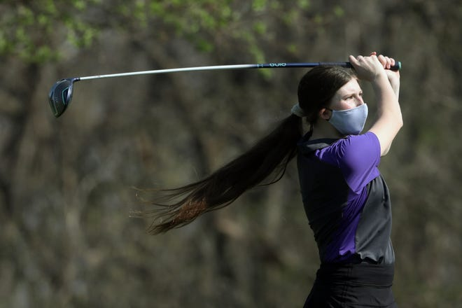 Burlington High School's Izzy Taylor tees off during the girls varsity invitational Tuesday April 6, 2021, at Flint Hills Golf Course.