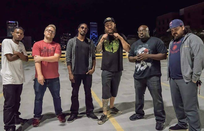 Jacksonville-based progressive hip hop band Universal Green plays the second Jax River Jams concert on Thursday, April 15, opening for pop-punk group New Found Glory. Pictured are singer Artez Burney, drummer Jason Hunnicutt, singer Darryl Green, bass player Cory Hawkins, tombone/sousaphone player Adrian Jackson and guitarist Jack Ringca.