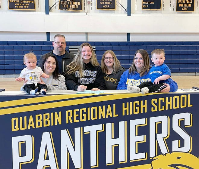 Taking part in a family photo last month when Julia Hamel signed her commitment letter to attend Worcester State University is (left-to-right): nephew Tyler Gallant, sister Miranda Hamel, father Dennis Hamel, Julia Hamel, sister Kayla Gallant, mother Amie Hamel and nephew Weston Hiltz.