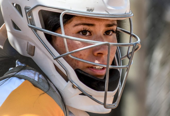 Garden City Community College catcher Erykah Foster gets a sign from the dugout for the next pitch March 27 against Barton County at Tangeman Sports Complex.