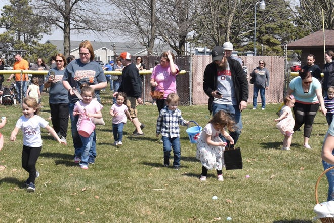 Three- and four-year-olds take part in the Bill Dahl Memorial Easter Egg Hunt on Saturday, April 3, in one of the youth diamonds in Love Park. Contributions from Orion Fall Festival and Orion Family Pharmacy helped Orion Veterans of Foreign Wars Post 143 and Orion American Legion Post 255