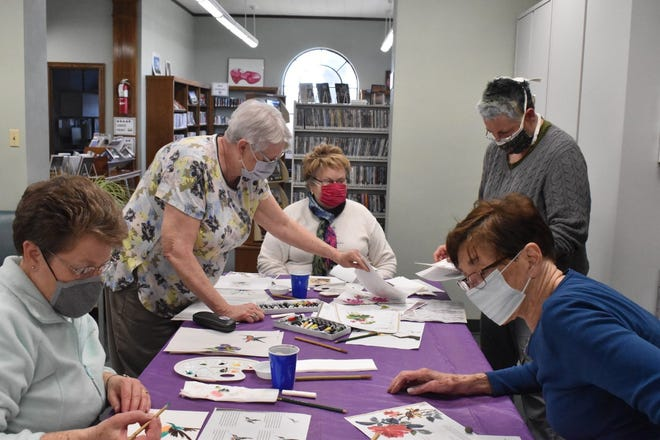 Western District Library's Georgia Veyette, standing at left, taught six sessions of Chinese brush painting in March and early April, including this session on Thursday, April 1. They were so popular she has scheduled more for April in the Orion library. In front are Tracy Hepner, left, and Marolyn Toper, and in back, Veyette, Sandy McSwain and Janet Jacobson.