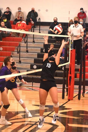 Orion's Ashley Awbrey sets the ball during the first match point in the Chargers' contest with the visiting Sherrard Tigers on Tuesday, March 30.