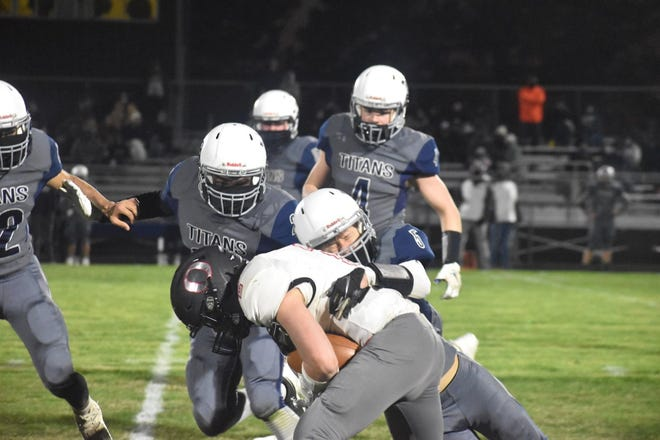 Orion's Coby Schultz, front, goes down at the end of an 18-yard run early in the third quarter of a 13-8 win over Monmouth-Roseville on Thursday, April 1, at Sunny Lane Field, Monmouth.