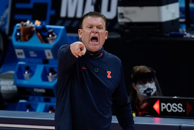 Illinois head coach Brad Underwood points against Loyola Chicago during the first half of a second round  game of the NCAA tournament at Bankers Life Fieldhouse in Indianapolis, Sunday, March 21, 2021.