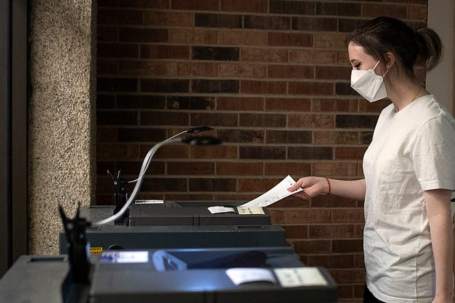 Voters cast their ballots in the Galesburg consolidated election on Tuesday, April 6, 2021, at Galesburg City Hall.