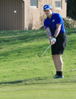 Central Christian's Connor Langlois chips onto the green on hole 1 during the Nickerson Invitational Golf Tournament at Crazy Horse golf course Monday.