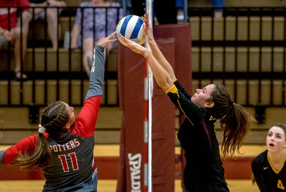 Morton's Olivia Pippin, left, fights at the net during a 2019 match against East Peoria. She is one of the Peoria area's top volleyball players returning to the court in fall of 2021.