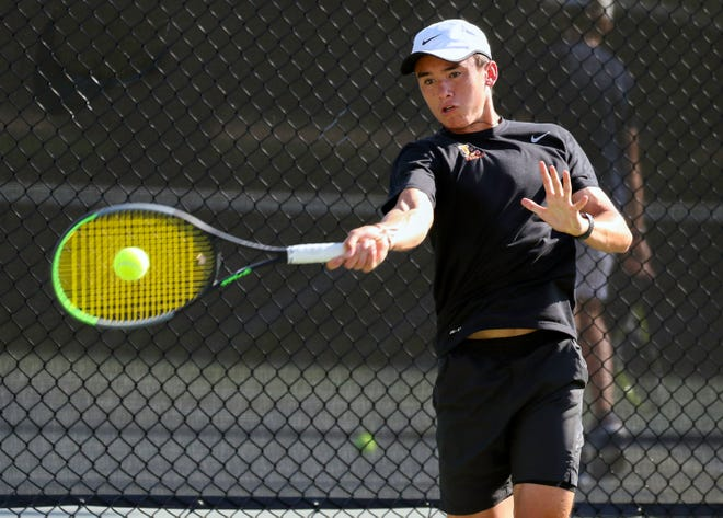 Lakeland No. 1 singles player Sam Reeder returns a shot during the West Boys Tennis Tournament at the Beerman Family Tennis Center.