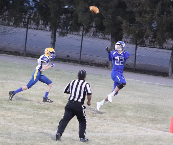 Las Animas' TJ Ortiz, right, with one of his two receptions of the night, this one resulting in a touchdown Friday, April 2, 2021, at Jack LaSalle Trojan Field.