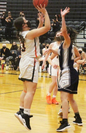 La Junta High School's Angelina Sanchez puts up a shot against James Irwin in a game played in February. Sanchez was an honorable mention All-League selection.