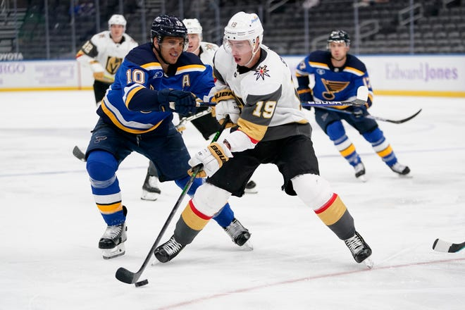 Vegas Golden Knights' Reilly Smith (19) controls the puck as St. Louis Blues' Brayden Schenn (10) defends during the third period of an NHL hockey game Monday, April 5, 2021, in St. Louis.