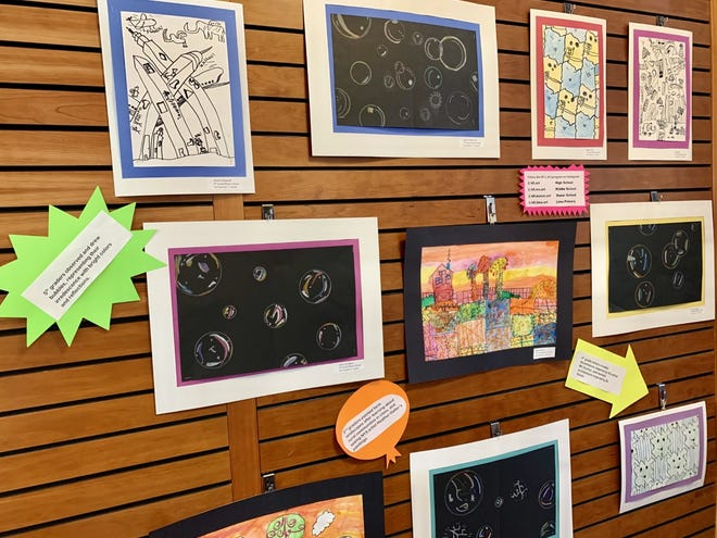A collection of landscapes, illustrations and drawings by Honeoye Falls-Lima students on display at Mendon Public Library.