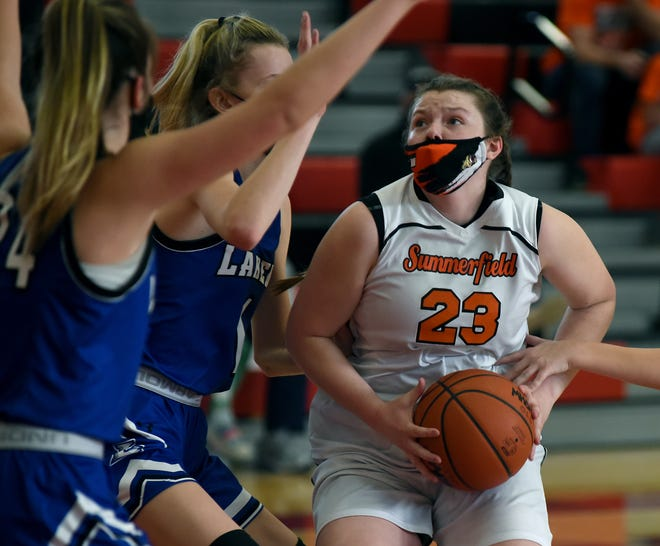 Abby Haller of Summerfield looks to go to the basket against Quinn Bobak and Brooklyn Robak of Waterford Our Lady of Lakes in the Division 4 quarterfinals held at Lake Shore High School Monday.