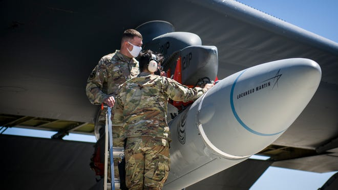 """In this August photo, Master Sgt. John Malloy and Staff Sgt. Jacob Puente of the 912th Aircraft Maintenance Squadron at Edwards Air Force Base in California secure the AGM-183A Air-launched Rapid Response Weapon (ARRW) Instrumented Measurement Vehicle 2 to the wing of a B-52H Stratofortress before a """"captive carry"""" test flight. On Monday, the Air Force experienced an unsuccessful test of an ARRW booster vehicle."""