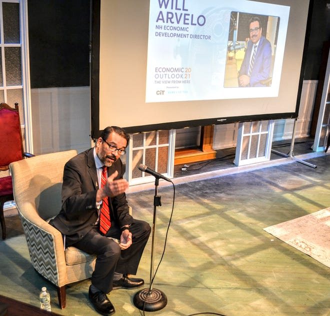Economic Development Director Will Arvelo reviews data pointing to a recovery from the COVID-19 pandemic during a hybrid in-person and remote forum Tuesday morning at Seacoast Repertory Theatre put on by the Chamber Collaborative of Greater Portsmouth. photo