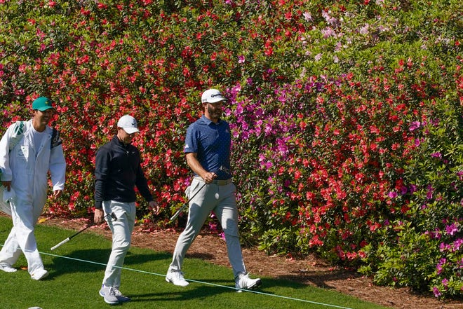 Rory McIlroy and Dustin Johnson stride down the sixth fairway ion Monday during a practice round for the Masters golf tournament at Augusta National Golf Club. [Michael Madrid-USA TODAY Sports]