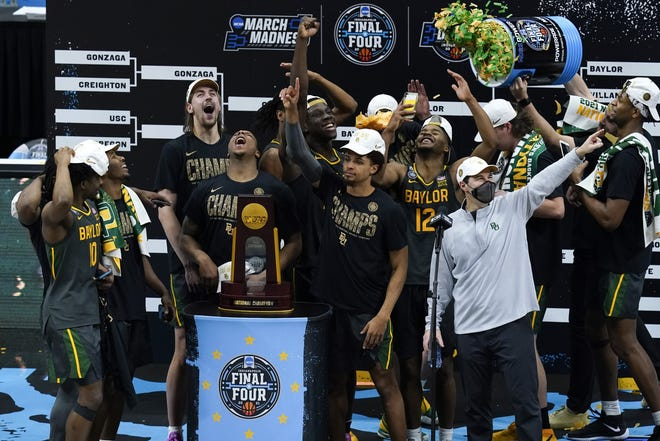Baylor players and coaches celebrate after defeating Gonzaga in the NCAA Final Four championship game Monday night at Lucas Oil Stadium in Indianapolis.