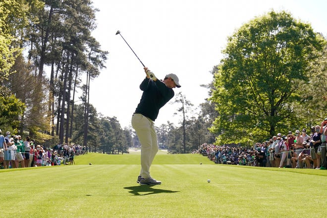 Rory McIlroy hits his tee shot on the 7th hole during a practice round for the Masters Monday at Augusta National.