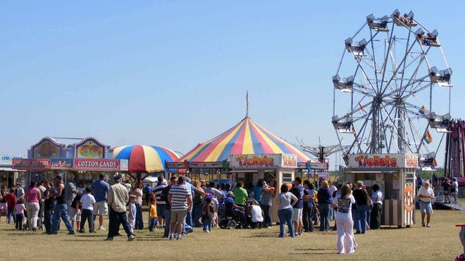 The midway and carnival attractions synonymous with  the International Acadian Festival.