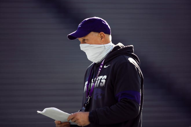 Kansas State coach Chris Klieman checks his notes during a recent spring practice.