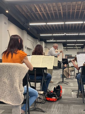 Interim music conductor for the Salina Symphony David Littrell conducts during a practice for the Spring Outdoor Chamber Concert Series  during Monday's rehearsal at the 5th Street Symphony Rehearsal Hall, 132 S. 5th Street.