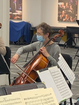 Dena Berquist practices during the Salina Symphony's strings rehearsal for the upcoming Spring Outdoor Chamber Concert.
