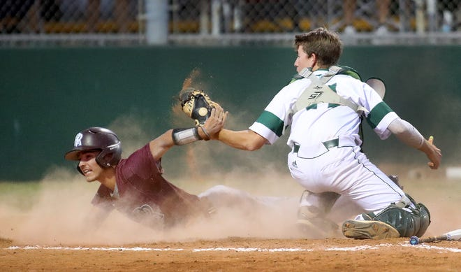Riverview's Carter Knight (3) is tagged out at the plate by Venice's Stephen Deans (14) during their district game Monday evening in Venice.
