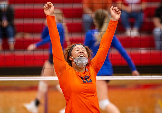 Rochester High School's Tatum Outlaw (12) celebrates a kill at Pleasant Plains in the first game on Monday, April 5. [Justin L. Fowler/The State Journal-Register]