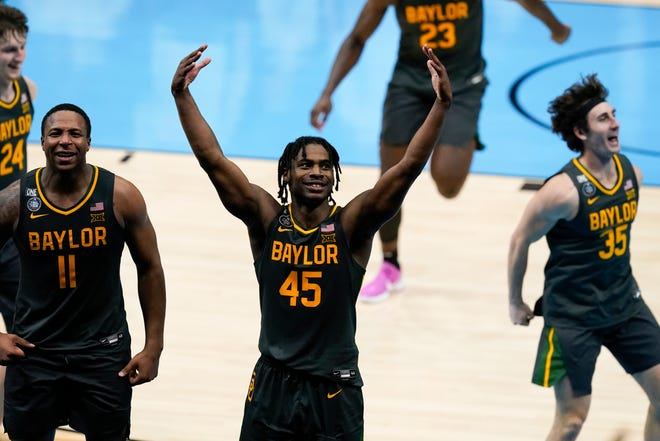 Baylor guard Davion Mitchell (45) of Hinesville celebrates at the end of the NCAA Tournament championship game against Gonzaga on Monday night, April 5, 2021, at Lucas Oil Stadium in Indianapolis. Baylor won 86-70.