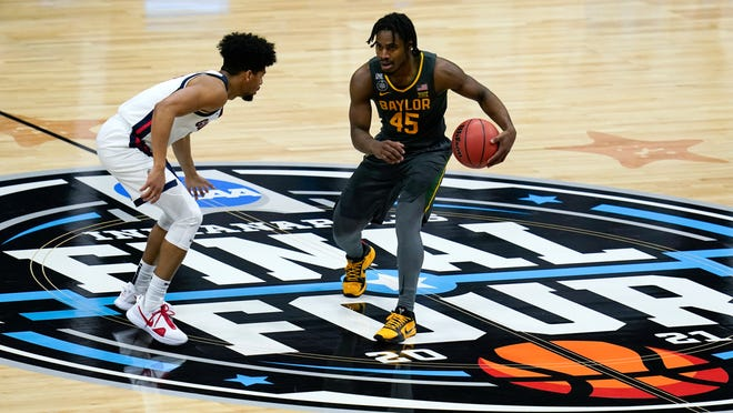 Baylor guard Davion Mitchell (45) drives around Gonzaga guard Aaron Cook (left) during the NCAA Tournament championship game on April 5 at Lucas Oil Stadium in Indianapolis.