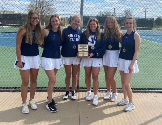 The Shawnee High School girls' tennis team poses with the Suburban Conference Tournament championship trophy on Monday.