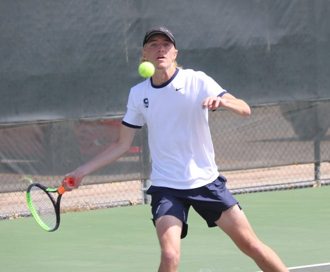 Shawnee's Aidan Grein makes the return during Suburban Conference Tennis Tournament action on Monday.