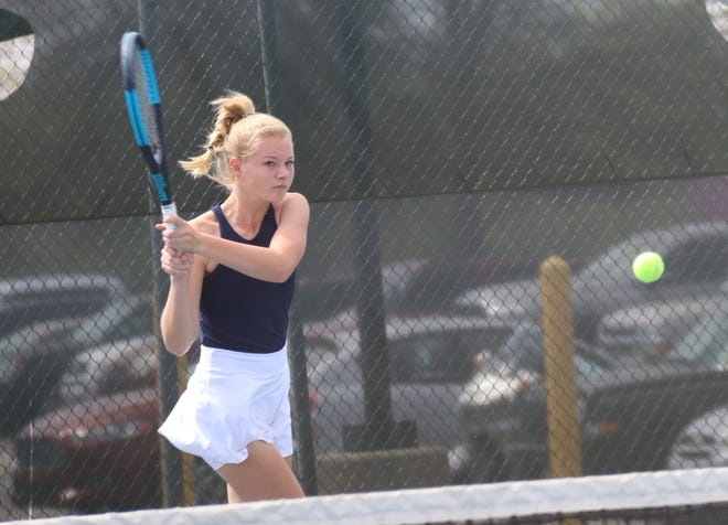 Shawnee No. 1 singles performer Olivia Stobbe makes a backhand return during action Monday in the Suburban Conference Tournament at the Paul Duffield Tennis Center.