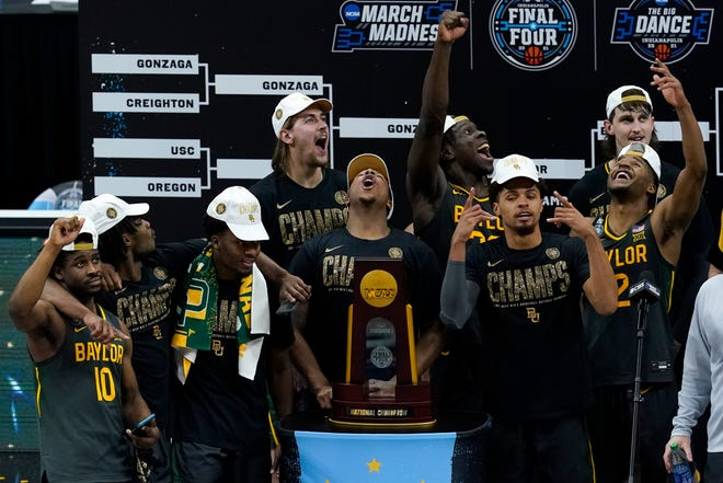 Baylor players celebrate with the trophy after the championship game against Gonzaga in the men's Final Four NCAA college basketball tournament, Monday, April 5, 2021, at Lucas Oil Stadium in Indianapolis. Baylor won 86-70.