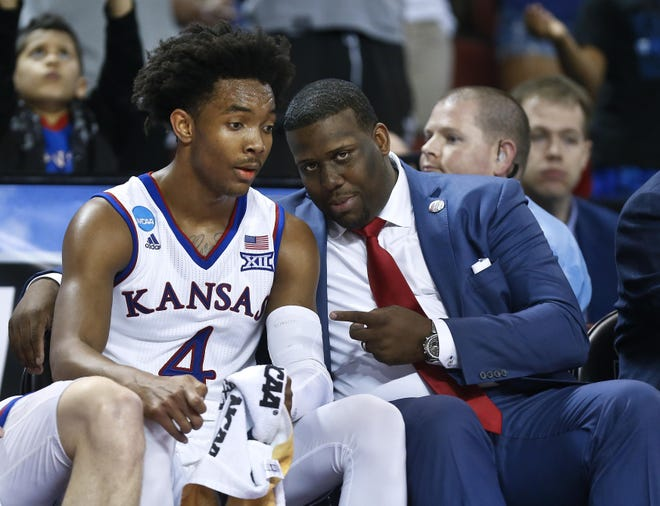 Jerrance Howard, right, poses with Devonte' Graham during the 2018 NCAA Tournament. Howard, who spent eight season as an assistant coach with the Jayhawks, has left the program to accept that same position with Texas, Bill Self announced Tuesday.