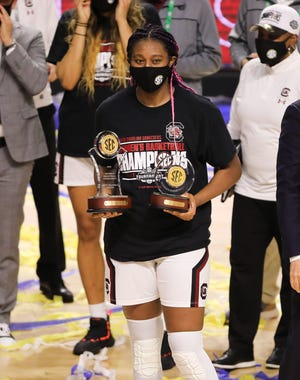South Carolina forward Aliyah Boston holds the SEC Tournament MVP and SEC All-Tournament Team awards after defeating Georgia in the SEC Conference Championship.