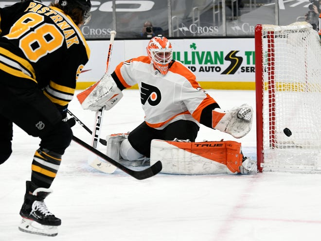A shot from Bruins right wing David Pastrnak goes wide of Flyers goaltender Brian Elliott during the first period Monday night at TD Garden.