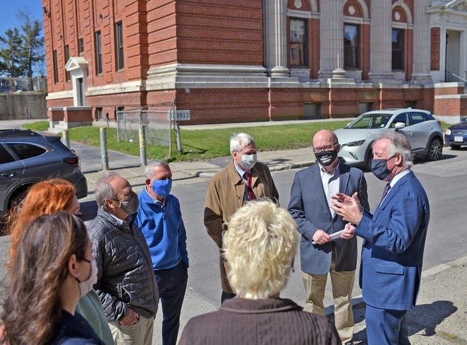 U.S. Rep. Richard Neal, far right, speaks outside the Creative Hub Worcester center Tuesday on Ionic Avenue.