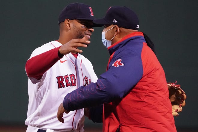 Red Sox shortstop Xander Bogaerts, left. hugs Boston Red Sox manager Alex Cora after Monday night's win over the Rays at Fenway Park.