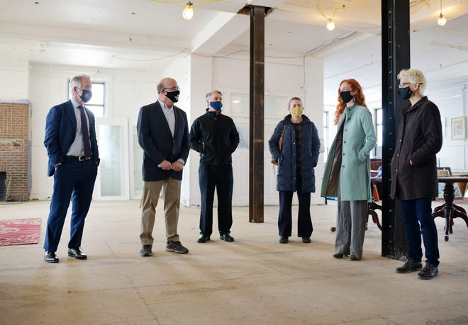 Creative Hub Co-Founders Laura Marotta and Stacy Lord, fifth and sixth from left, conduct a tour of the former Ionic Avenue Boys Club building,