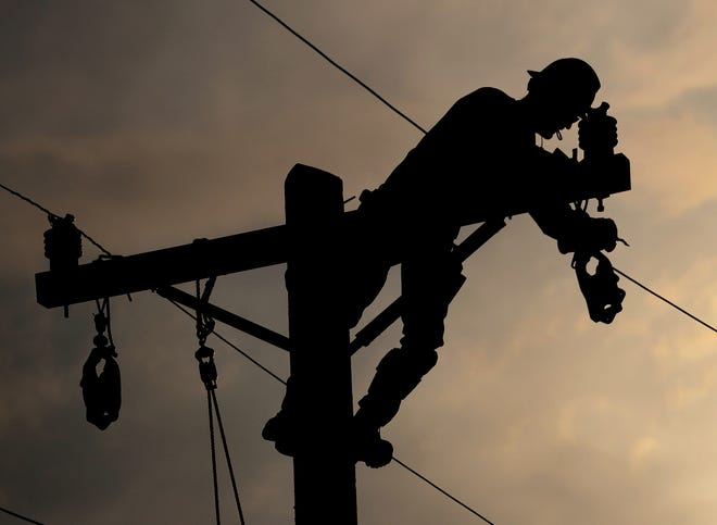 A lineman competes during the Florida Lineman Competition at the Gainesville Regional Utilities' Eastside Operations Center in Gainesville in 2012.