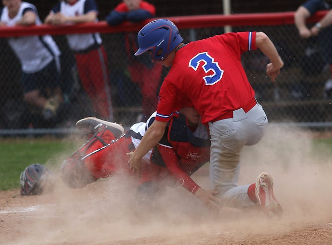 Garaway's baserunner Brady Roden is tagged out at the plate by Indian Valley's catcher Tanyon McComb in Monday's game.