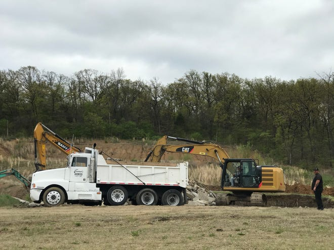 Demolition of a concrete foundation at 3201 Phoenix Ave. was part of groundwork this spring for a new Dollar General store. As of early July, the store is expected to be completed in 30 to 60 days.