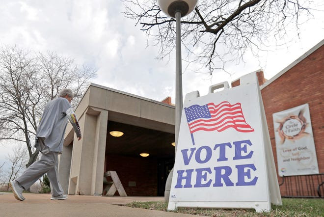 Voters at the polls at First Congregational United Church of Christ on Tuesday in Appleton.