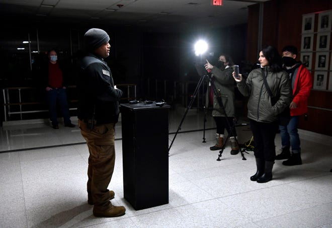 City of Abilene emergency management coordinator Vincent Cantu speaks to media during a press conference regarding the failure of the city's water system during severe winter weather Feb. 15. The press conference was in the darkened hallway outside of council chambers at Abilene City Hall, which was operating under generator power due to citywide power outages.