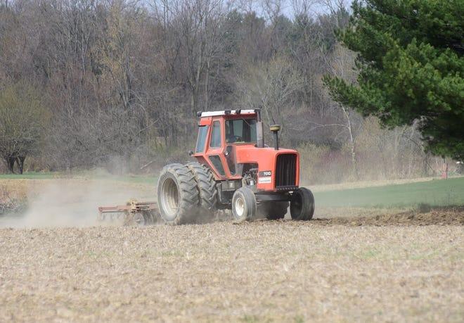A farmer disks his field Tuesday morning near Galion.